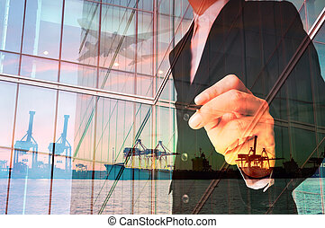 Double Exposure of Businessman writing and Port Cargo and...