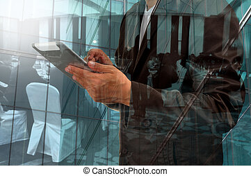 Double Exposure of Businessman and Business Meeting or...