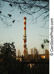 Chimney - Industrial chimney smoking in the cloudy weather