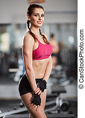 Fitness model posing in gym