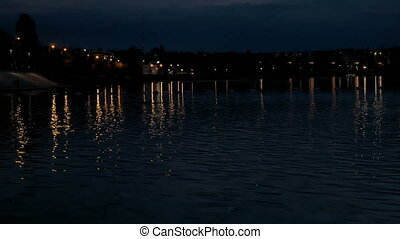 Beautiful lights reflection in water at night.