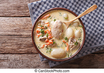 Creamy soup with chicken and vegetables close up. Horizontal...