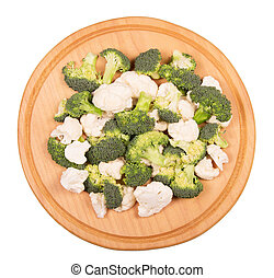 Broccoli and cauliflower, round wooden board isolated on white