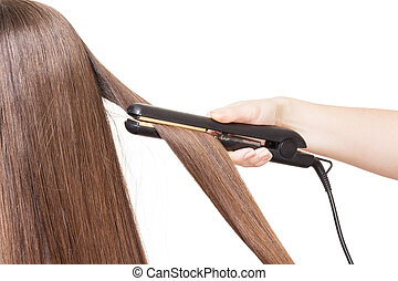 Hairdresser smoothes hair curling isolated on white...