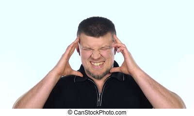 Headache. White. Slow motion - Man with big headache against...
