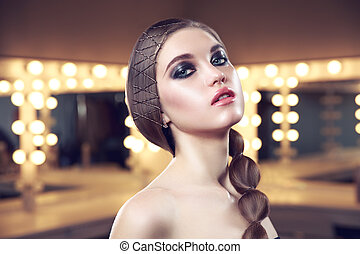 Beauty woman with perfect skin and elegant hairstyle in...