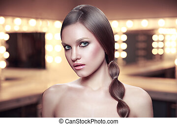Beauty portrait of girl with beautiful makeup and long braid...
