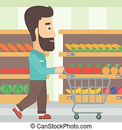 Customer with trolley - A hipster man with the beard pushing...