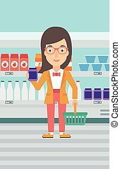 Customer with shopping basket and tube of cream - A woman...