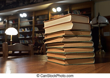 piles of books on table