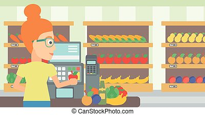 Cashier at supermarket checkout - A cashier at supermarket...