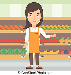 Friendly supermarket worker - A supermarket worker showing...