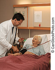 doctor taking senior blood pressure - Doctor taking seniors...