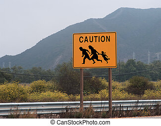 immigrant crossing - highway sign showing family crossing