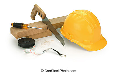 carpentry on white - hard hat, saw, 2x4, screwdriver on...