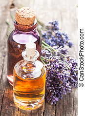 The essential oil - Glass bottle of essential oil and dry...