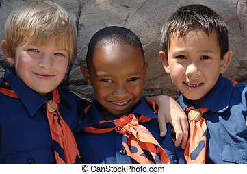 Cub Scouts - Three boys of diverse ethnic background in cub...
