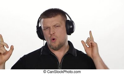 Funny guy with headphones listening to music. White
