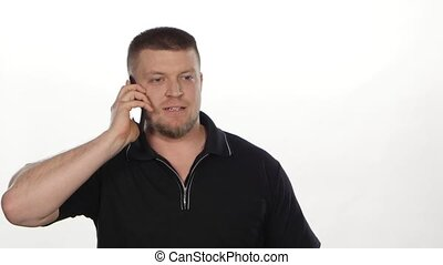 Angry man talking on phone. White - Angry man talking on...