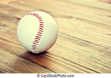 Baseball game. Baseball ball on wooden background. Vintage...