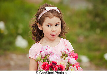 Girl with bouquet of pink flowers for mom on mothers day...