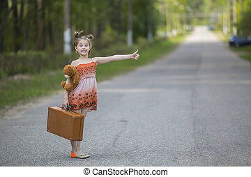 Little girl hitchhiker - Funny little girl hitchhiker with a...