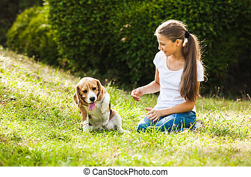 Girl plays with a dog