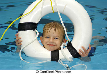 lifesaver - boy in pool with lifesaver...