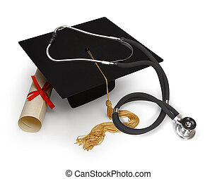 medical education - mortar board, diploma and stethoscope on...