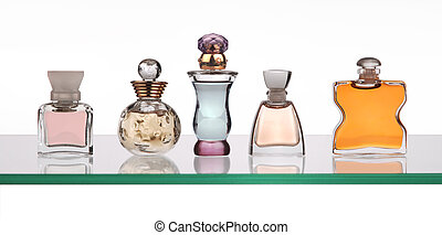 perfume bottles on glass shelf