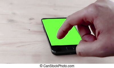 man hand using a smart phone in the office with chroma key,...