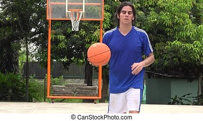 Man Playing Basketball Making Layup