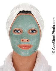 spa mud mask - front view of a beautiful young woman in...