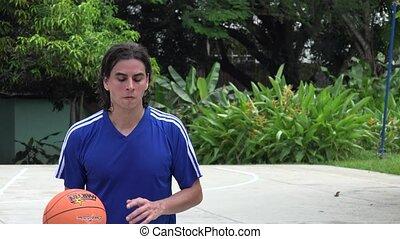 Man Playing Basketball Making Layup