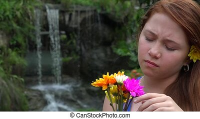 Pretty Young Girl With Flowers