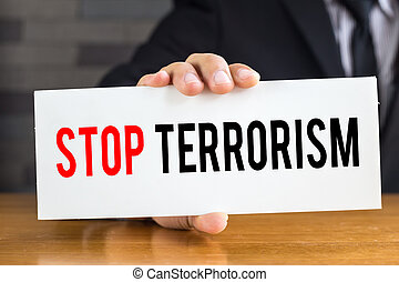 Stop terrorism, message on white card and hold by...