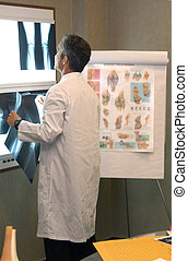 joint specialist - orthopaedic surgeon reviewing x-rays...
