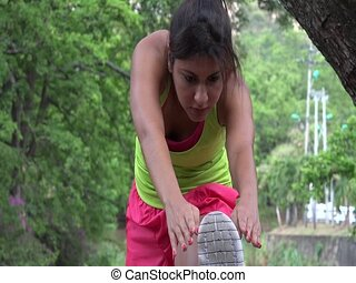 Fit Woman Stretching And Exercising
