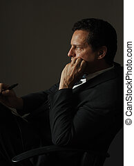 listening - business executive listening intently and taking...