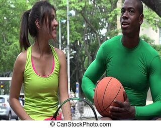 Athletic Man And Woman Talking