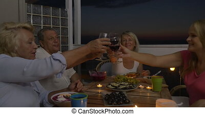 People enjoying food and wine during home dinner - Steadicam...