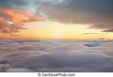 sunrise in the heavens - high altitude sunrise in layered...