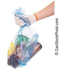 Hand holds garbage bag with household waste isolated on white