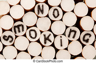 No smoking written on the cigarette filter - Inscription no...