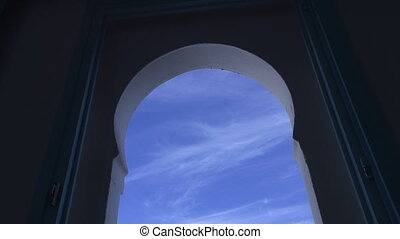 Arch window zoom in blue sky - Traditional arched arabian...