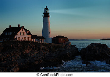 lighthouse shining at dawn