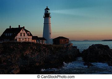 lighthouse shining at dawn - Portland lighthouse shining...