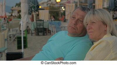 Senior couple relaxing on resort - Senior family couple...