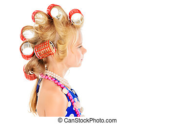 big curlers - Funny little girl in her mother's hair curlers...