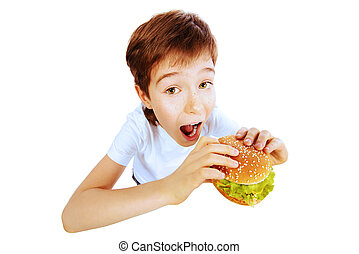 good appetite - Happy nine year old boy eating burger with...